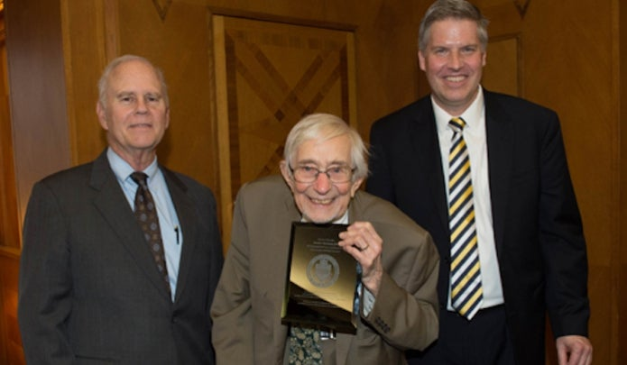 Jerome M. Rosenberg (center) with Chancellor Patrick Gallagher (right) and George A. Huber (left).